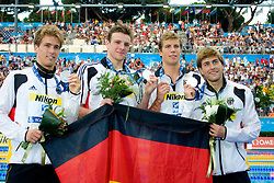 Helge Meeuw (R), Hendrik Feldwehr (L), Benjamin Starke (2ndR) and Paul Biedermann (2nd L) of Germany receive the silver medal during the medal ceremony for the Men's 4x 100m Medley Relay Final during the 13th FINA World Championships Roma 2009, on August 2, 2009, at the Stadio del Nuoto,  in Foro Italico, Rome, Italy. (Photo by Vid Ponikvar / Sportida)