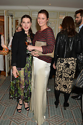 Left to right, LILY LEWIS and ANNABELLE SHEPPARD at the launch of Mrs Alice in Her Palace - a fashion retail website, held at Fortnum & Mason, Piccadilly, London on 27th March 2014.