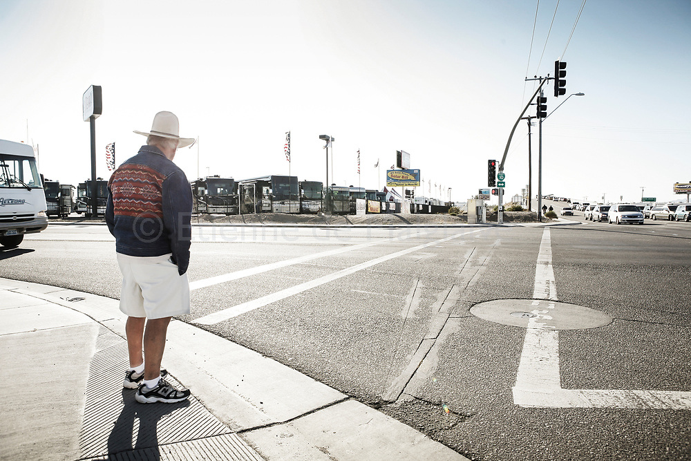 A elderly man watches road traffic in Quartzsite.<br /> 21 January 2008.