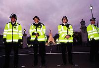 police officers outside Buckingham Palace during demonstration against President Bush's visit.