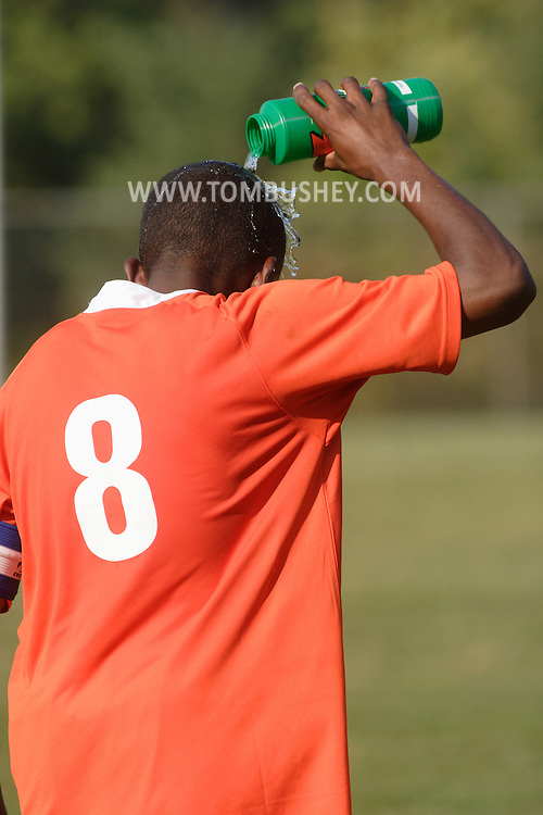 Middletown, N.Y. - A Hostos Community College player dumps water on his head to cool off during a men's soccer game against Orange County Community College on Oct. 6, 2007.