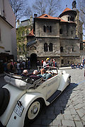 A vintage car tour stops at the Jewish Ceremonial Hall at the Old Jewish cemetery in Josefov, the former Jewish ghetto in Prague, Czech Republic. The cemetery was used from 1439 to 1787 and it is the oldest existing Jewish cemetery in Europe.