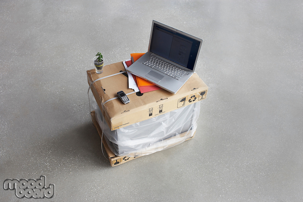 Laptop on top of boxes