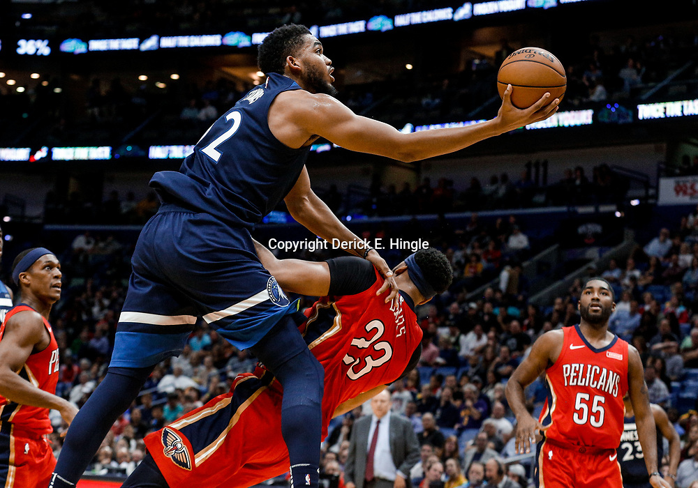 Nov 29, 2017; New Orleans, LA, USA; New Orleans Pelicans forward Anthony Davis (23) draws a charge from Minnesota Timberwolves center Karl-Anthony Towns (32) during the second quarter of a game at the Smoothie King Center. Mandatory Credit: Derick E. Hingle-USA TODAY Sports