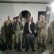 National Security Adviser Condoleezza Rice and White House Chief of Staff Andy Card look on as Pres. Bush spends Thanksgiving dinner with troops of the 1st Armor Division in a mess hall at Baghdad International Airport Thursday, November 27, 2003.  In a clandestine night time move President Bush, with the knowledge of only a handful of senior staff, departed his ranch in Crawford, Texas and flew through the night to spend the Thanksgiving Day holiday visiting troops stationed in the war torn country...Photo by Khue Bui