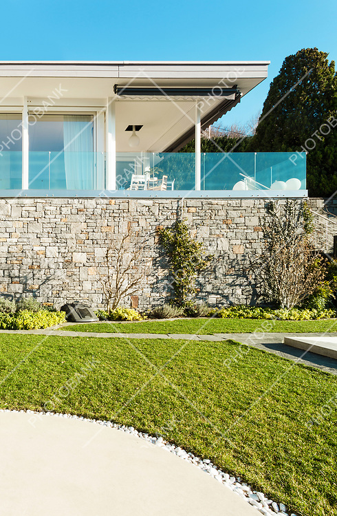 Modern house, wall in stone, outdoor