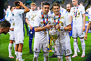 Leeds United midfielder Pablo Hernandez (19) and Leeds United defender Gjanni Alioski (10) pose with the trophy during the EFL Sky Bet Championship match between Leeds United and Charlton Athletic at Elland Road, Leeds, England on 22 July 2020.