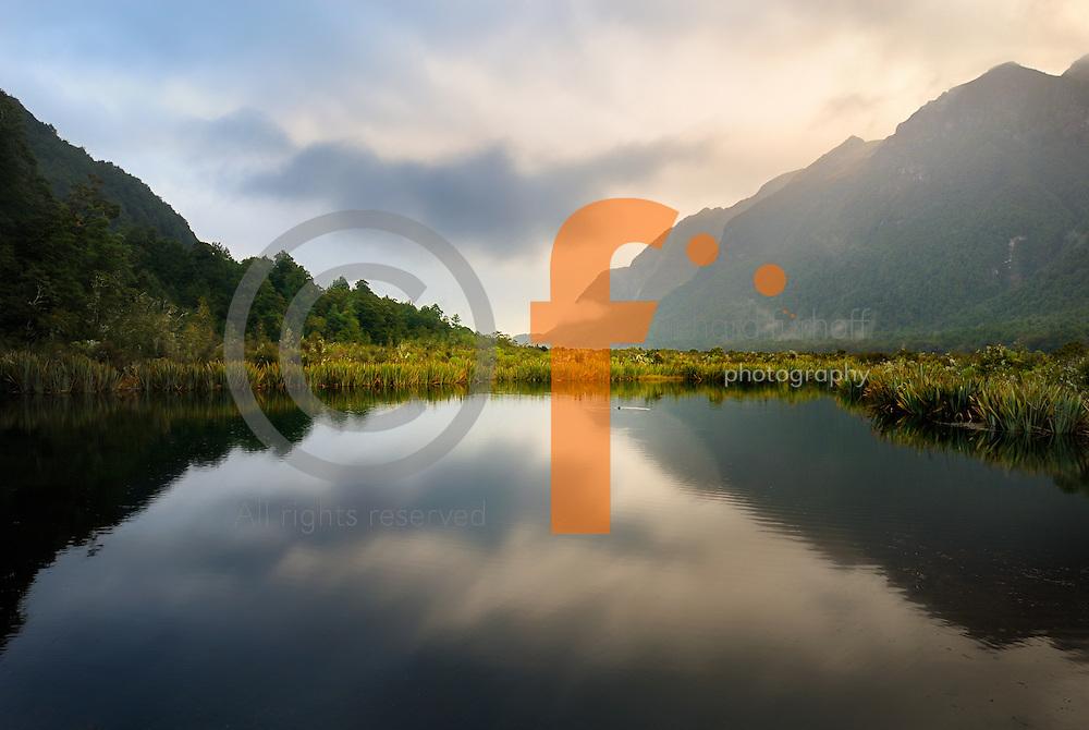 Richard Furhoff 100101_NewZealand_DSC4633_1A.tif .Mirror Lake, Fiordlands National Park, New Zealand..