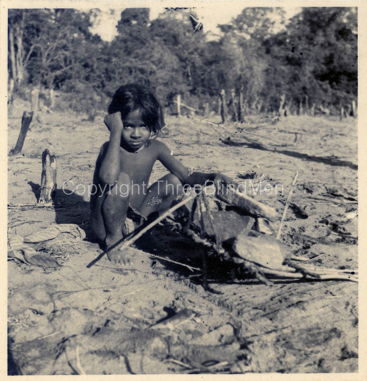 Vedda boy with small dead-fall for trapping small animals. R. L. Spittel  Colombo
