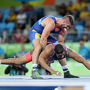 Wrestling - Olympics: Day 11  Daniel Lugo Cabrera of Cuba in action against against Carl Fredrik Stefan Schoen of Sweden in the Men's Greco-Roman 98 kg semi final contest during the wrestling tournament at the Carioca Arena 2 on August 16, 2016 in Rio de Janeiro, Brazil. (Photo by Tim Clayton/Corbis via Getty Images)