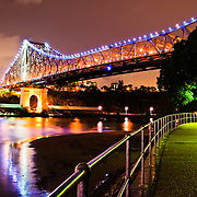 Brisbane's Story Bridge at night from Captain Burke Park looking along Brisbane River