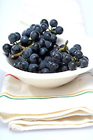Grapes on white plate - close-up