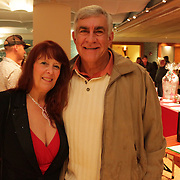 Anita Edwards, left, and Dave Fedora pose for a photo Friday November 28, 2014 during the Atlantic Marine Holiday Flotilla Launch Party. (Jason A. Frizzelle)