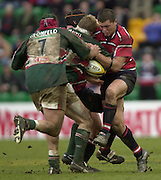 © Peter Spurrier/ Intersport Images.Photo Peter Spurrier.01/03/2003 Sport - Semi final Powergen Cup Rugby -.Leicester  v Gloucester - Franklin Gardens.Oliver Smith is held up by James forrester (cap0 and Henry Paul.