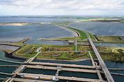 Nederland, Zeeland, Philipsdam, 23-10-2013; Krammersluizen onderdeel van de Schelde-Rijnverbinding. De sluizen bevinden zich tussen het zoete water van het  Volkerak en het zoute water de Oosterschelde (via de Krammer). Autoverkeer rijdt over de N257. Grevelingendam in de achtergrond.<br /> Philipsdam with Krammersluizen, part of the Delta Works<br /> luchtfoto (toeslag op standaard tarieven);<br /> aerial photo (additional fee required);<br /> copyright foto/photo Siebe Swart.