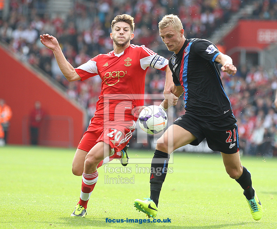 Picture by Paul Terry/Focus Images Ltd +44 7545 642257<br /> 28/09/2013<br /> Adam Lallana of Southampton and Dean Moxey of Crystal Palace during the Barclays Premier League match at the St Mary's Stadium, Southampton.
