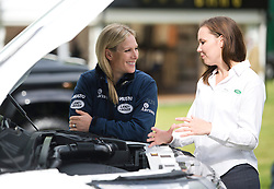 © London News Pictures. 08/05/2012. Windsor, UK.  Zara Phillips talking to Technical Apprentice Carolyn Lee from Land Rover at the launch of the Range Rover Evoque Scholarship on Day one of the Royal Windsor Horse Show, set in the grounds of Windsor Castle.  Photo credit: Ben Cawthra/LNP
