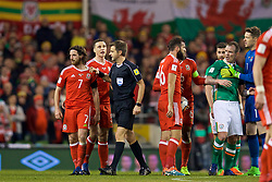 DUBLIN, REPUBLIC OF IRELAND - Friday, March 24, 2017: Wales' Joe Allen and Referee Nicola Rizzoli during the 2018 FIFA World Cup Qualifying Group D match against Republic of Ireland at the Aviva Stadium. (Pic by David Rawcliffe/Propaganda)