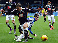 Keiran Lee of Sheffield Wednesday tackles Stephen Warnock of Derby County during the Sky Bet Championship match at Hillsborough, Sheffield<br /> Picture by Graham Crowther/Focus Images Ltd +44 7763 140036<br /> 06/12/2015