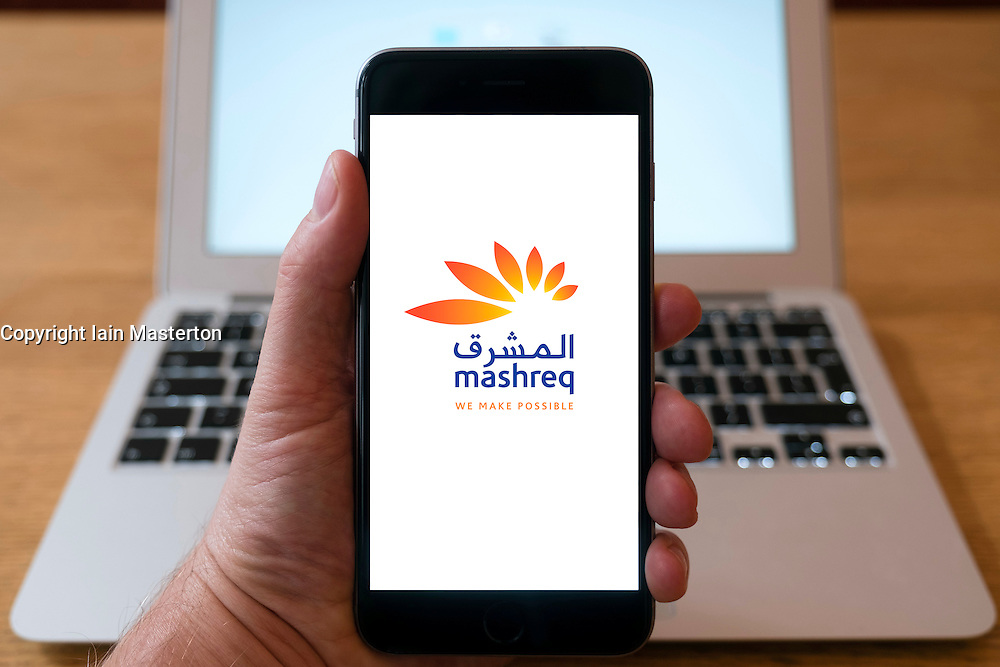 Using iPhone smart phone to display website logo of Mashreq Bank from United Arab Emirates