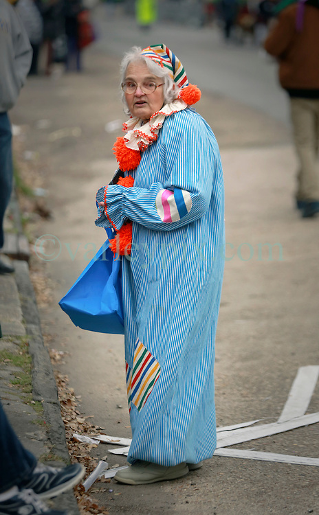 04 March 2014. New Orleans, Louisiana.<br /> Fat Tuesday. Mardi Gras Day. An elderly reveler awaits the early morning Krewe of Zulu parade.<br /> Photo; Charlie Varley/varleypix.com