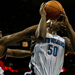March 30, 2011; New Orleans, LA, USA; Portland Trail Blazers guard Wesley Matthews (2) is called for a flagrant foul against New Orleans Hornets center Emeka Okafor (50) during the first half at the New Orleans Arena.    Mandatory Credit: Derick E. Hingle