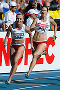 (R) Weronika Wedler and (L) Ewelina Ptak both from Poland compete in women's relay 4x100 meters qualification during the 14th IAAF World Athletics Championships at the Luzhniki stadium in Moscow on August 18, 2013.<br /> <br /> Russian Federation, Moscow, August 18, 2013<br /> <br /> Picture also available in RAW (NEF) or TIFF format on special request.<br /> <br /> For editorial use only. Any commercial or promotional use requires permission.<br /> <br /> Mandatory credit:<br /> Photo by &copy; Adam Nurkiewicz / Mediasport