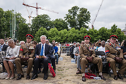 © Licensed to London News Pictures. 22/06/2017. London, UK. Defence Secretary Michael Fallon (left of centre) attends the inauguration of the African Caribbean War Memorial in Windrush Square in Brixton, south London, on Windrush Day. The memorial remembers the many African and Caribbean servicemen that fought in the Second World War. Photo credit: Rob Pinney/LNP