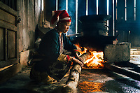 A Red Dao woman manages a still of traditional rice wine in the mountains of northern Vietnam.