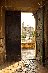 Viiew through an old doorway in Orvieto, Umbria, Italy.