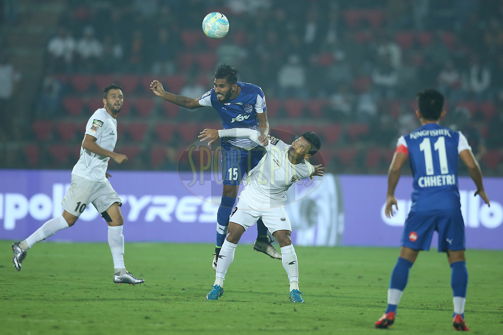 Subhasish Bose of Bengaluru FC and Seiminlen Doungel of Northeast United FC in action during match 19 of the Hero Indian Super League between NorthEast United FC and Bengaluru FC held at the Indira Gandhi Athletic Stadium, Guwahati India on the 8th December 2017<br /> <br /> Photo by: Deepak Malik  / ISL / SPORTZPICS