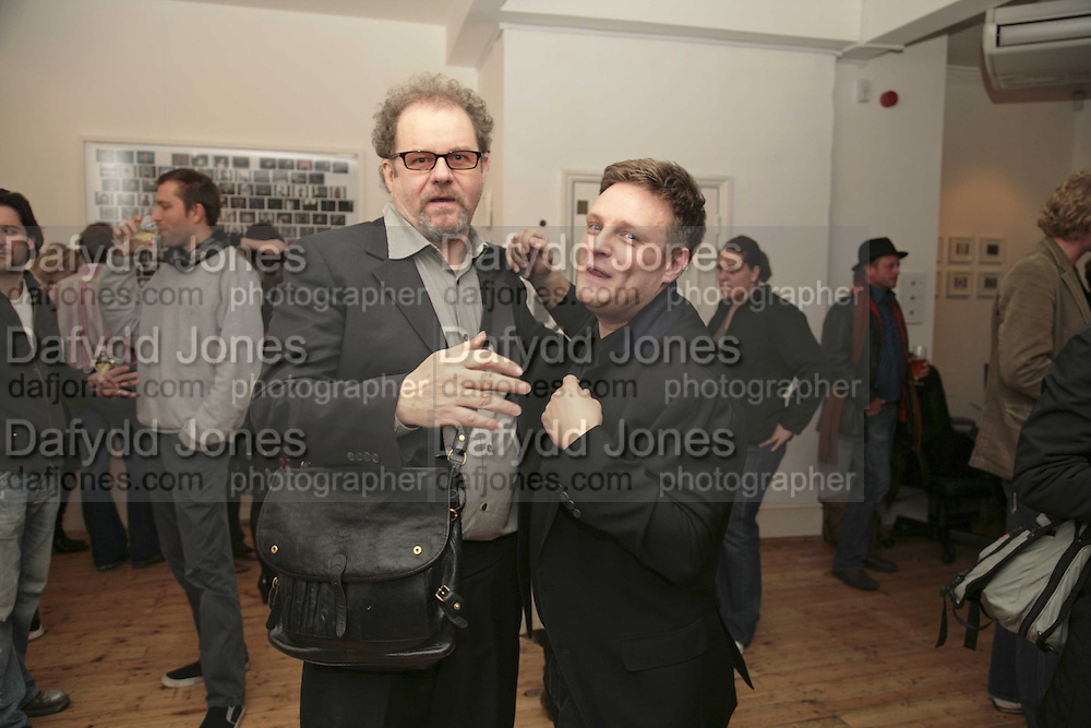 MIKE FIGGIS AND RANKIN, Exhibition of Polaroids by Rankin. The Gallery, 125 Charing Cross Road, London, WC2 7 December 2006. ONE TIME USE ONLY - DO NOT ARCHIVE  © Copyright Photograph by Dafydd Jones 248 CLAPHAM PARK RD. LONDON SW90PZ.  Tel 020 7733 0108 www.dafjones.com