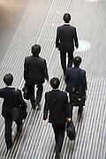 group of businessmen walking