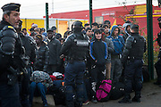 CALAIS, FRANCE - OCT 25: Refugees wait to leave the Calais 'jungle' camp as its dismantlement begins in Calais, France on October 25, 2016.