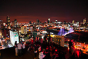 Revellers drinking at the Rand Lords roof top bar over looking Johannesburg city centre. South Africa. ©www.lightfootphoto.com