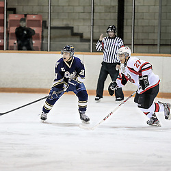 PICKERING, ON - Jan 31 : Ontario Junior Hockey League Game Action between the Pickering Panthers Hockey Club, and Toronto Lakeshore Patriots Hockey Club, Riley Devine #27 of the Pickering Panthers Hockey Club skates after the puck with Nicolas Ursitti #21 of the Toronto Lakeshore Patriots Hockey Club<br /> (Photo by Keith White / OJHL Images)