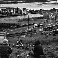 People relax at sunset in Newcastle