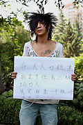 Chow Liang - 17 Yrs.<br /> Hair stylist student on way to see father who works in another province.<br /> Gansu Province.<br /> <br /> 'In adults eyes I am a bad person in society, but in fact I am a very obedient person'.