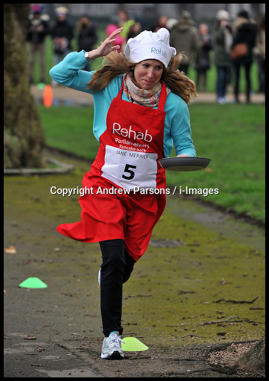Independent on Sunday Political editor Jane Merrick takes part in the MP's and Lords race against political Journalist in the Rehab Parliamentary Pancake Shrove Tuesday race a charity event which sees MPs and Lords joined by media types in a race to the finish. Victoria Tower Gardens, Westminster, Tuesday February 12, 2013. Photo By Andrew Parsons / i-Images