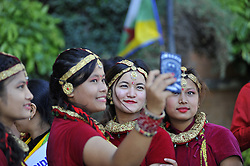 August 9, 2016 - Kathmandu, NE, Nepal - Nepalese girl in a traditional attire takes selfie during the International Day of the 22nd World Indigenous Day celebrated in Kathmandu, Nepal, 09 August 2016. At the call of the United Nations, on August 9 every year the International Day of the World's Indigenous People observed by organizing different programs. (Credit Image: © Narayan Maharjan/NurPhoto via ZUMA Press)