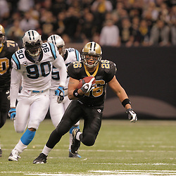2008 December, 28: New Orleans Saints running back Deuce McAllister (26) runs away from Carolina Panthers defensive end Julius Peppers (90) during a week 17 game between NFC South divisional rivals the Carolina Panthers and the New Orleans Saints at the Louisiana Superdome in New Orleans, LA.