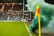 A smoke grenade is thrown from the Hibernian stand onto the pitch during the Ladbrokes Scottish Premiership match between Hibernian and Rangers at Easter Road, Edinburgh, Scotland on 19 December 2018.