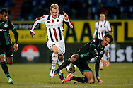 Onderwerp/Subject: Willem II - FC Groningen - Eredivisie<br /> Reklame:  <br /> Club/Team/Country: <br /> Seizoen/Season: 2012/2013<br /> FOTO/PHOTO: Aurelien JOACHIM (L) of Willem II in duel with Virgil VAN DIJK (R) of FC Groningen. (Photo by PICS UNITED)<br /> <br /> Trefwoorden/Keywords: <br /> #04 $94 &plusmn;1355238911262<br /> Photo- &amp; Copyrights &copy; PICS UNITED <br /> P.O. Box 7164 - 5605 BE  EINDHOVEN (THE NETHERLANDS) <br /> Phone +31 (0)40 296 28 00 <br /> Fax +31 (0) 40 248 47 43 <br /> http://www.pics-united.com <br /> e-mail : sales@pics-united.com (If you would like to raise any issues regarding any aspects of products / service of PICS UNITED) or <br /> e-mail : sales@pics-united.com   <br /> <br /> ATTENTIE: <br /> Publicatie ook bij aanbieding door derden is slechts toegestaan na verkregen toestemming van Pics United. <br /> VOLLEDIGE NAAMSVERMELDING IS VERPLICHT! (&copy; PICS UNITED/Naam Fotograaf, zie veld 4 van de bestandsinfo 'credits') <br /> ATTENTION:  <br /> &copy; Pics United. Reproduction/publication of this photo by any parties is only permitted after authorisation is sought and obtained from  PICS UNITED- THE NETHERLANDS