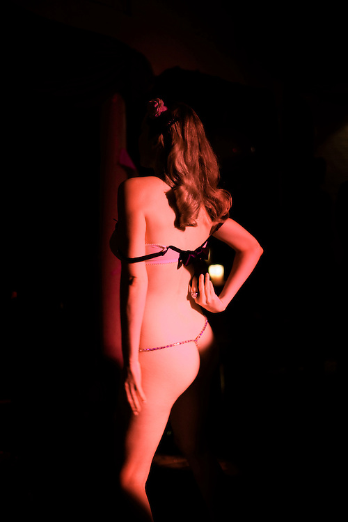 Miss Miranda begins her Burlesque performance. Dalston. London, UK. 2009