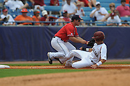 South Carolina's Whit Merrifield (5) is safe at third as Mississippi's Zach Miller takes the throw during the Southeastern Conference tournament at Regions Park in Hoover, Ala. on Wednesday, May 26, 2010. Ole Miss won 3-0.
