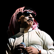 """October 3, 2015 - New York, NY : The performance artist Laurie Anderson collaborated with former Guantánamo detainee, Mohammed el Gharani, in the production of """"Habeas Corpus,"""" an art installation featuring a larger-than-life projection of el Gharani displayed in the Park Avenue Armory drill hall. Here, the Syrian-born musician Omar Souleyman performs on stage in """"Out of Body,"""" a performance component of the exhibit held in the drill hall on Friday night. CREDIT: Karsten Moran for The New York Times"""