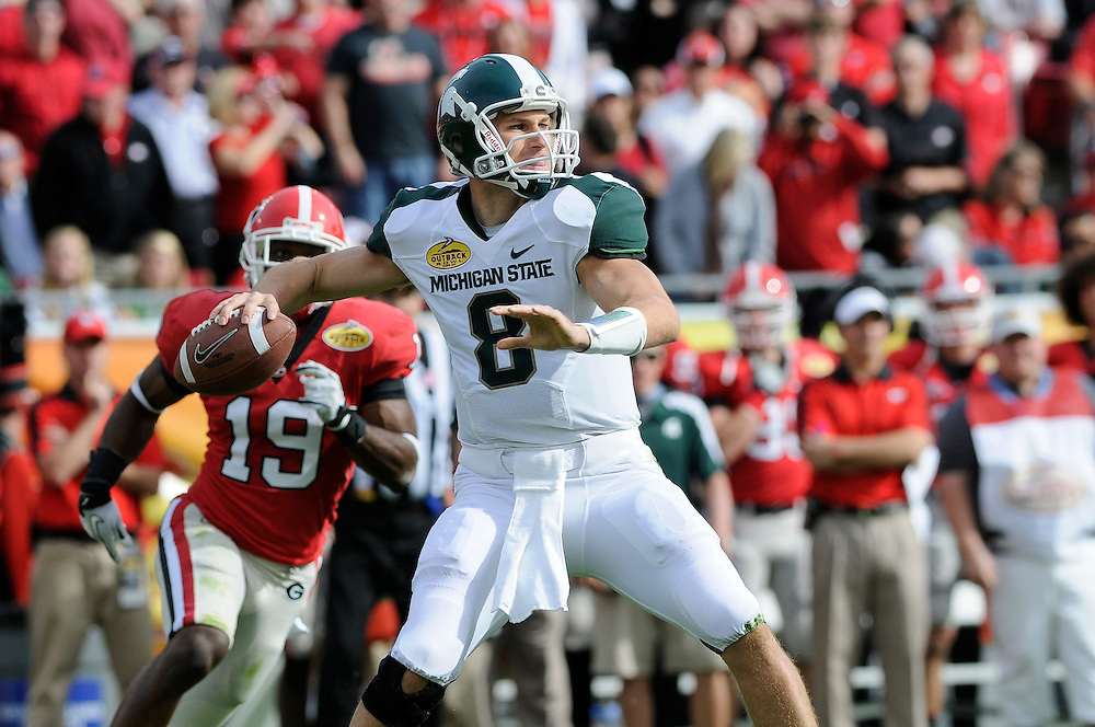 January 2, 2012: Kirk Cousins of Michigan State rolls out to pass during the NCAA football game between the Michigan State Spartans and the Georgia Bulldogs at the 2012 Outback Bowl at Raymond James Stadium in Tampa, Florida.