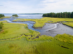 A tidal creek flows through a salt marsh into Great Bay in Newmarket, New Hampshire. The Nature Conservancy's Lubberland Creek Preserve.
