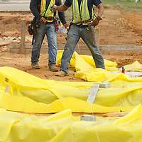 Workers with Gene Waters Concrete of Guntown, a subcontractor with Century Construction, prepare the footings for concrete at the construction site of the Fairpark Towers in Tupelo on Tuesday morning.