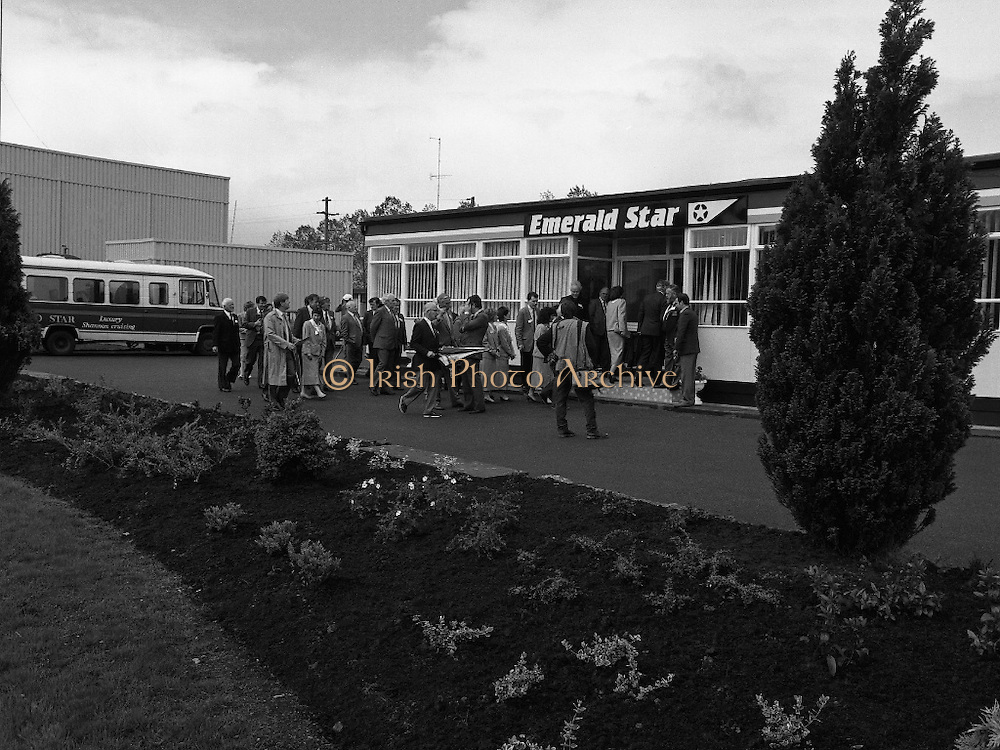 New Facilities At Emerald Star Line.   (R59)..1987..08.06.1987..06.08.1987..8th June 1987..the Minister for Transport and Tourism, Mr John Wilson TD opened a new Customer Service Facility at Emerald Star Line,Carrick on Shannon. Following the viewing of the facility and the planting of a commemorative tree, the Minister, accompanied by Mr Brian Slowey,Managing Director, Guinness,Ireland and Mr E H Bodell, Chairman, Emerald Star line departed on a cruise of The Shannon aboard an Emerald Star Cruiser...Picture shows the invited guests entering the new facility at Emerald Star Line.
